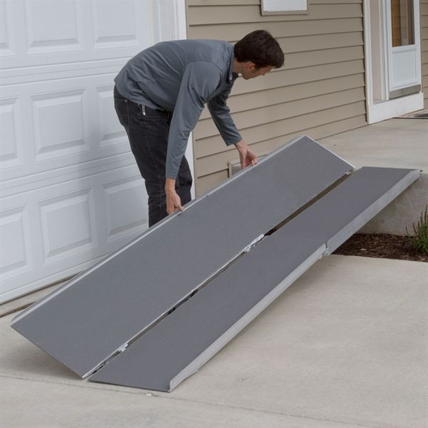 Wheelchair ramp, outdoors with natural lighting.