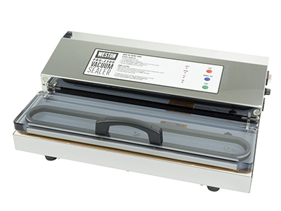 Weston vacuum sealer machine in studio with constant lighting.